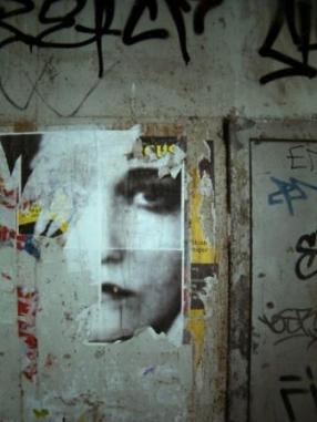 Girl's Face on a Wall by Daniel Zimmel